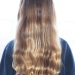 light brown with natural highlights. wavy and full.